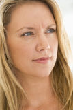 Head shot of woman scowling Stock Photo