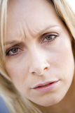 Head shot of woman scowling Stock Image