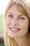 Head shot of woman smiling Royalty Free Stock Image