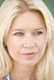 Head shot of woman thinking stock image