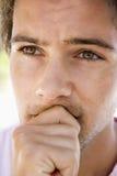 Head shot of worried man Stock Image