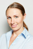 Head shot of young smiling businesswoman Stock Image