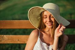 Head shot of young woman posing in park Stock Photo