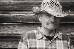 Head and shoulder portrait of a man in cowboy hat. Royalty Free Stock Photo