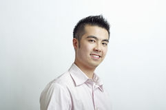 Head and shoulders Asian man. Young Asian man with spiky hair at a three quarters view Stock Image