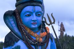 Head and shoulders of a colourful statue of the Hindu God,Shiva showing detail. Head and shoulders of a colourful blue statue of the Hindu God,Shiva showing Royalty Free Stock Photography