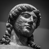 Head and shoulders detail of the ancient sculpture.  Royalty Free Stock Photos