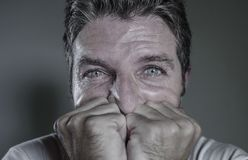 Head and shoulders dramatic portrait of young man crying in pain suffering depression and anxiety problem feeling stressed and. Desperate in looking devastated royalty free stock image