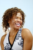Head and shoulders of a laughing woman. Head and shoulders of a woman laughing with her eyes closed Royalty Free Stock Photography