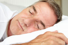 Head and shoulders mid age man sleeping