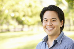 Head and shoulders portrait Asian man outdoors Royalty Free Stock Images