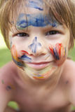Head And Shoulders Portrait Of Boy With Painted Face Stock Image