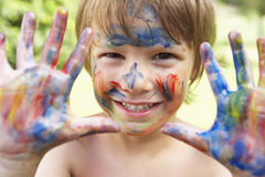 Head And Shoulders Portrait Of Boy With Painted Face and Hands Stock Photos