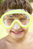 Head And Shoulders Portrait Of Boy Wearing Swimming Mask Stock Images
