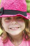 Head And Shoulders Portrait Of Girl Wearing Pink Straw Hat Stock Photos
