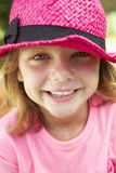 Head And Shoulders Portrait Of Girl Wearing Pink Straw Hat Royalty Free Stock Photography