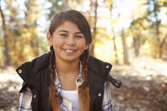 Head and shoulders portrait of a Hispanic girl in a forest Stock Photos
