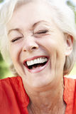 Head And Shoulders Portrait Of Laughing Senior Woman royalty free stock photos