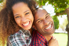 Head And Shoulders Portrait Of Loving Couple Outdoors Royalty Free Stock Photography