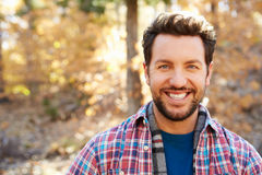 Head And Shoulders Portrait Of Man In Autumn Woodland Stock Photos