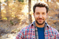 Head And Shoulders Portrait Of Man In Autumn Woodland Stock Images