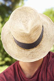 Head And Shoulders Portrait Of Man With Hat Covering Face Royalty Free Stock Photos