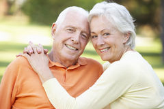 Head And Shoulders Portrait Of Romantic Senior Couple In Park Stock Photos