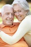 Head And Shoulders Portrait Of Romantic Senior Couple In Park Stock Image