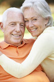 Head And Shoulders Portrait Of Romantic Senior Couple In Park Stock Images
