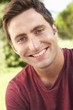 Head And Shoulders Portrait Of Smiling Man Stock Images