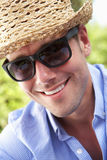 Head And Shoulders Portrait Of Smiling Man With Sun Hat Stock Images