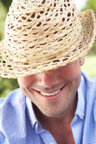 Head And Shoulders Portrait Of Smiling Man With Sun Hat Royalty Free Stock Photos