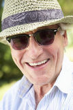 Head And Shoulders Portrait Of Smiling Senior Man With Sun Hat Royalty Free Stock Image