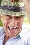 Head And Shoulders Portrait Of Smiling Senior Man With Sun Hat Stock Image