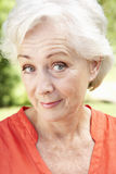 Head And Shoulders Portrait Of Smiling Senior Woman Stock Photo