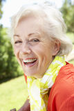 Head And Shoulders Portrait Of Smiling Senior Woman Stock Image