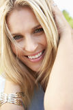 Head And Shoulders Portrait Of Smiling Woman Stock Image