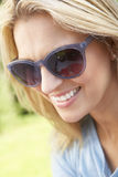 Head And Shoulders Portrait Of Smiling Woman With Sun Hat Royalty Free Stock Photo