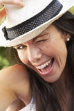 Head And Shoulders Portrait Of Smiling Woman With Sun Hat Stock Photo