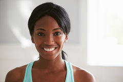 Head and shoulders portrait of smiling young black woman Stock Photography