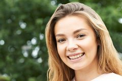 Head And Shoulders Portrait Of Smiling Teenage Girl Stock Images