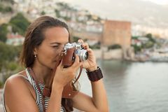 Traveller woman photographing using vintage camera Stock Image