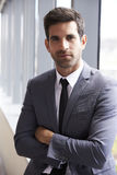 Head And Shoulders Portrait Of Young Businessman In Office royalty free stock photos
