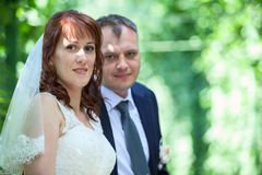 Head and shoulders portrait of young wedding couple Royalty Free Stock Photography