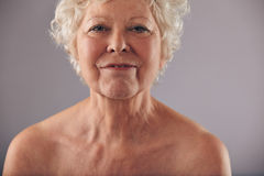 Head and shoulders of senior female Stock Images