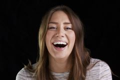 Head And Shoulders Studio Portrait Of Laughing Young Woman royalty free stock images
