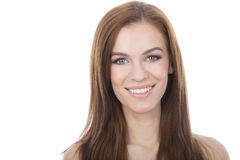 Head and shoulders studio portrait of a smiling woman. Isolated Stock Photo