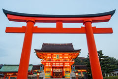 This is the head shrine of Inari in Japan. A giant torii gate in front of the Romon Gate at Fushimi Inari Shrine's entrance in Kyoto, Japan Royalty Free Stock Photography
