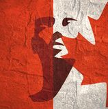 Head silhouette. Face front view. Human head silhouette. Face front view. Elegant silhouette of part of human face textured by Flag of Canada. Grunge concrete royalty free illustration