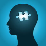 Head silhouette with missing jigsaw puzzle pea Royalty Free Stock Photography